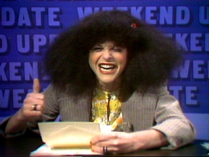 Gilda Radner as Roseanne Roseannadanna. But my hair's real!